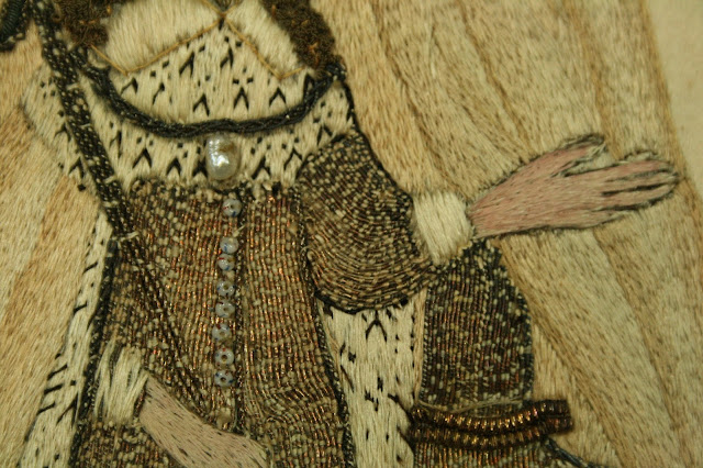 close-up detail of 17th century stump work embroidery conserved at Spicer Art Conservation, experts in the preservation and restoration of textiles
