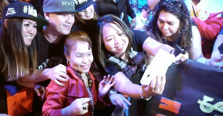 Mommy D taking selfie with fans
