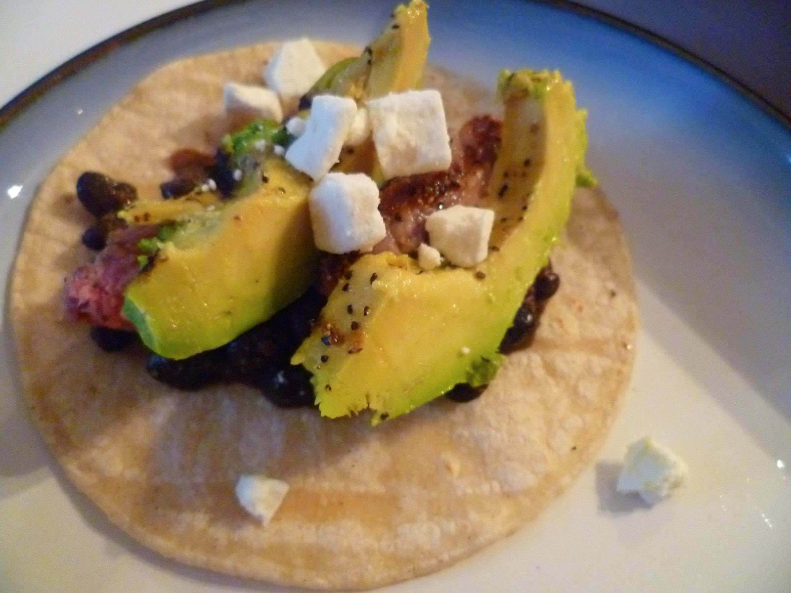 Assemble tacos; place spoonful of spiced black beans in tortilla, add ...