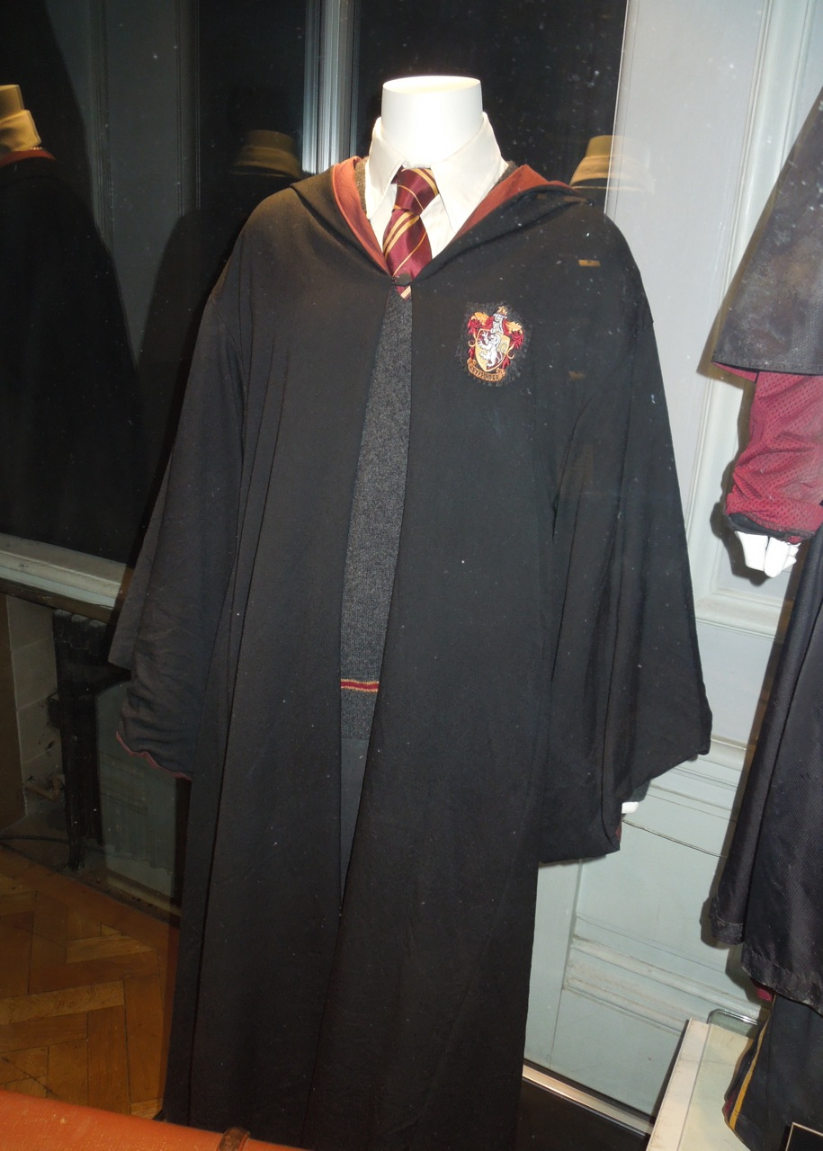 Harry Potter and Ron Weasley movie costumes on display... | Hollywood Movie Costumes