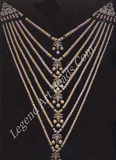 This pearl, emerald, and diamond necklace is instantly recognizable as a sat larha, or seven-stranded necklace, and also as a classic of Art Deco design. For a more traditional sat larha.