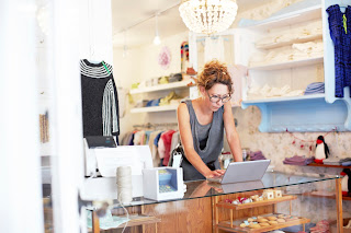 Retail business owner using computer