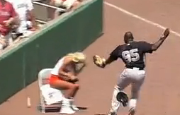 Hooters ballgirl ducks foul popup, nearly gets run over by Yankees infielder