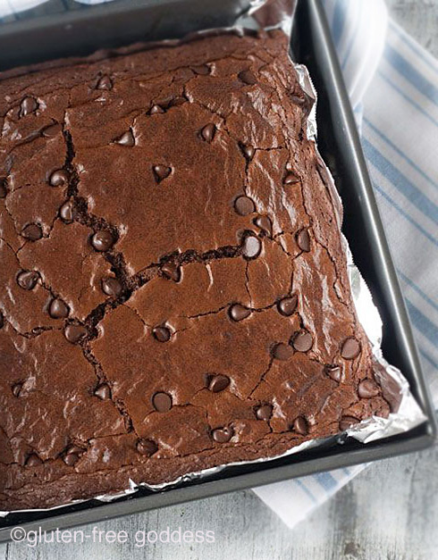 The best fudgy gluten-free brownie recipe with dark chocolate, from Karina, Gluten-Free Goddess. Party worthy.