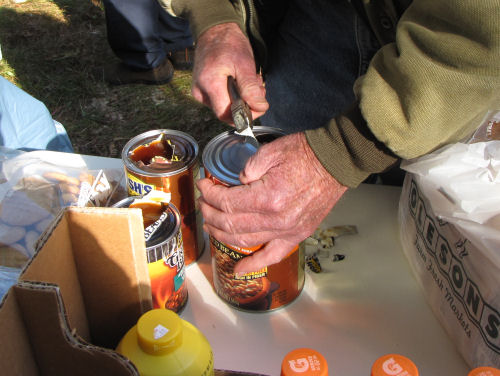 opening cans with a screwdriver and pliers