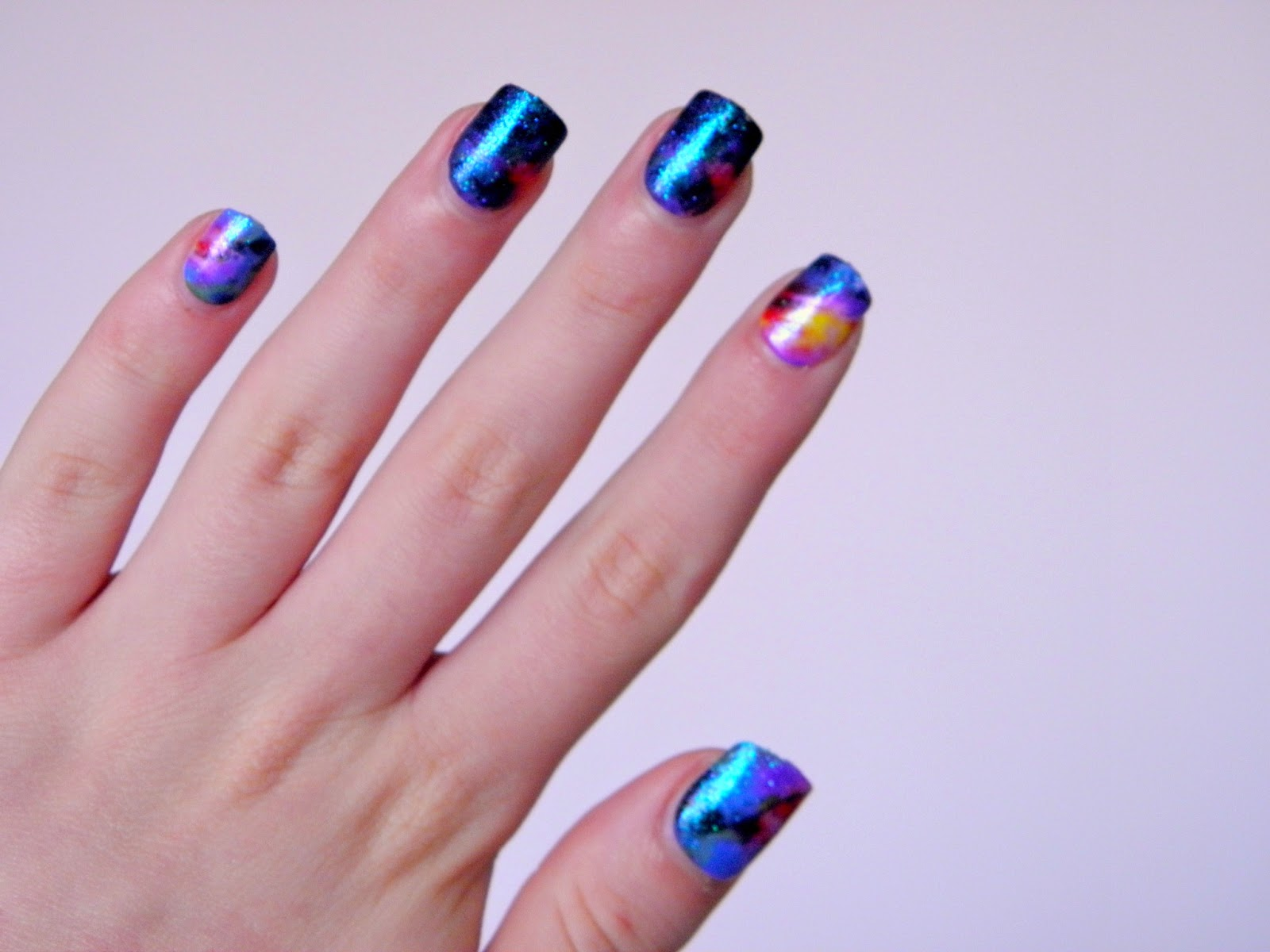 Galaxy nails geek gets glam how amazing are these galaxy style nails they are so easy to do too ill let you in on my galaxy nail tutorial that is so easy a nail novice could solutioingenieria Images