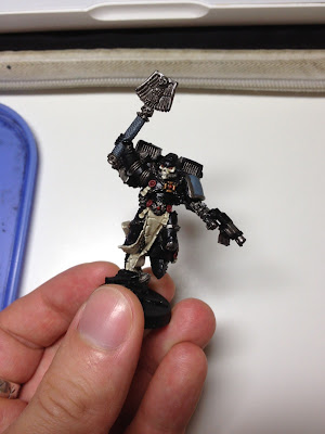 work in progress painting of a WArhmmer 40k RAven Guard Chaplain