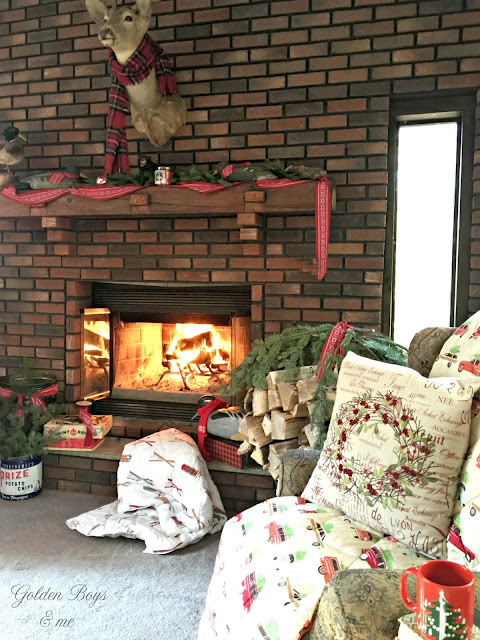 Rustic Christmas living room with brick fireplace and Garnet Hill down throws - www.goldenboysandme.com