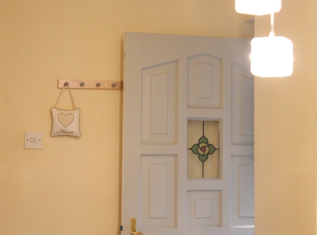 homely cottage interior  with stained glass door panel