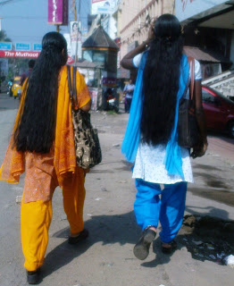 Tamil Nadu girls in loose long hair styles.
