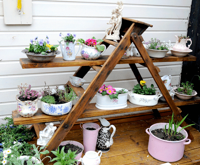 Vintage pots on old ladders