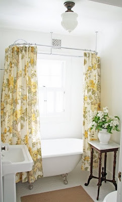 vintage clawfoot tub, flowery curtain