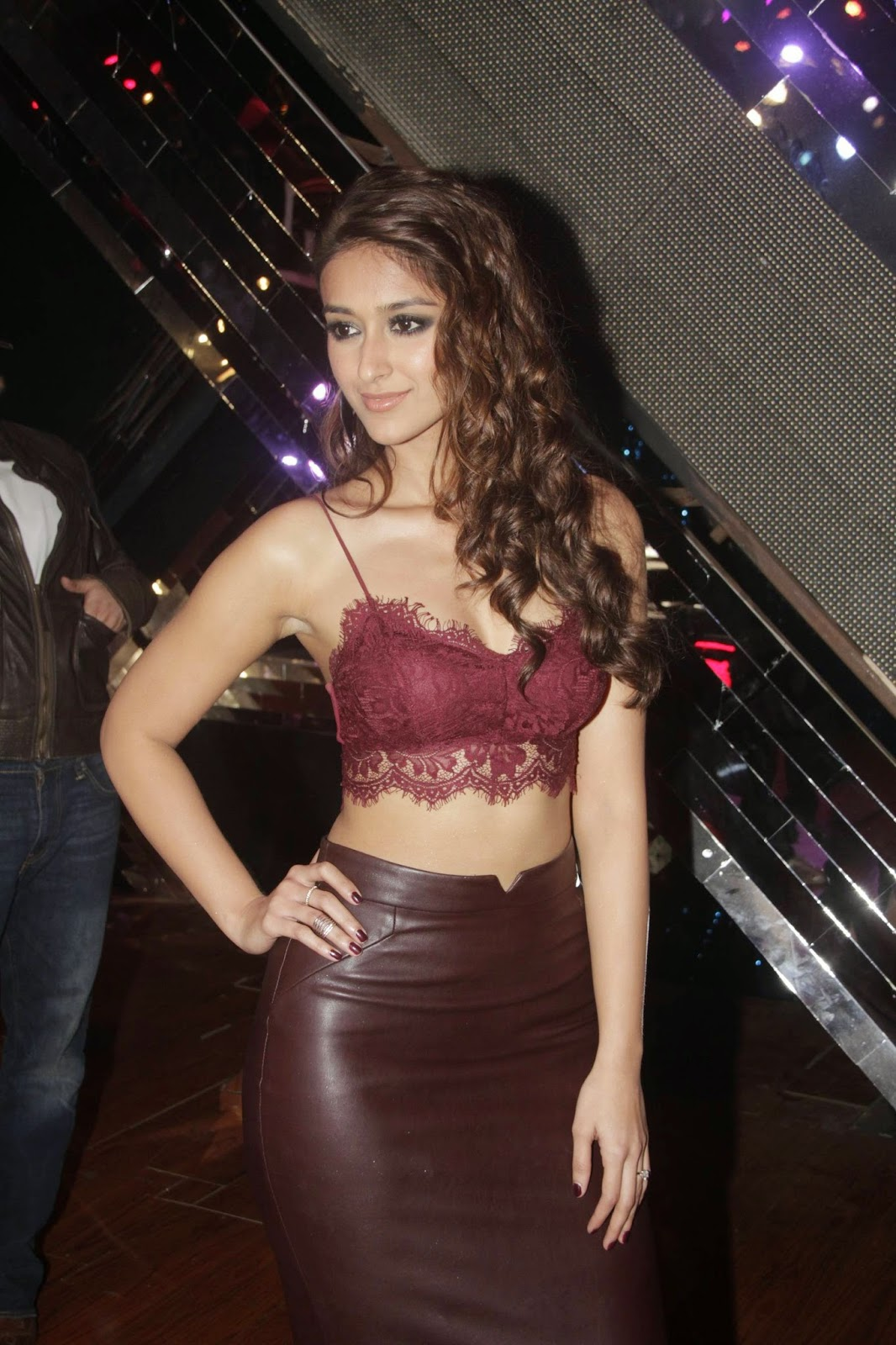 Ileana in Spicy Leather Skirt and Maroon Top Promoting Happy Ending at RAW Star Sets
