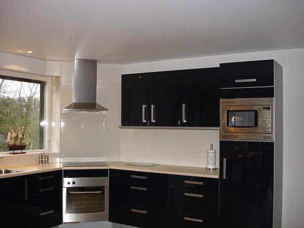 Contemporary Touches Such As A Hidden Cabinet Can Also Be Applied In Asian  Kitchen Design.