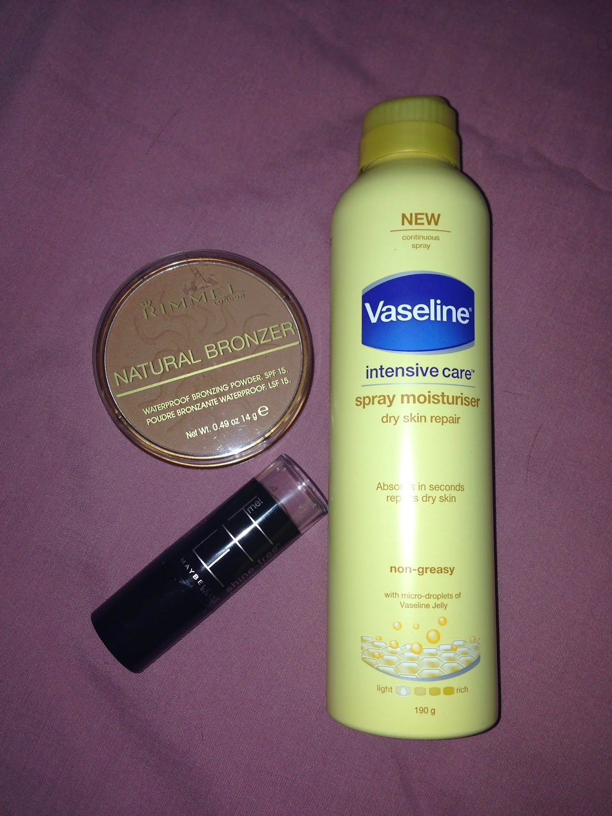 Maybelline Fit Me Shine-Free Foundation Stick in shade 235 Pure Beige, Rimmel London Natural Bronzer in Sun Bronze & Vaseline Intensive Care Spray Moisturiser for Dry Skin Repair