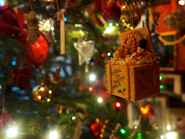 Toy box ornament amongst decorations and lights on the Christmas tree