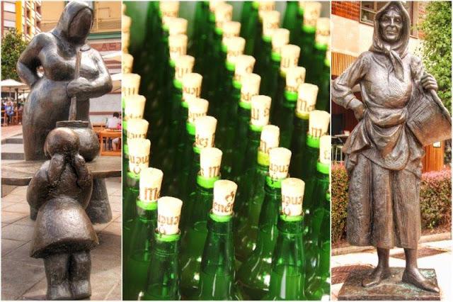 Esculturas Guisandera de Maria Luisa Sanchez Ocana y Gitana de Sebastian Miranda en la calle Gascona de Oviedo – Botellas de sidra en la calle Gascona Bulevar de la sidra