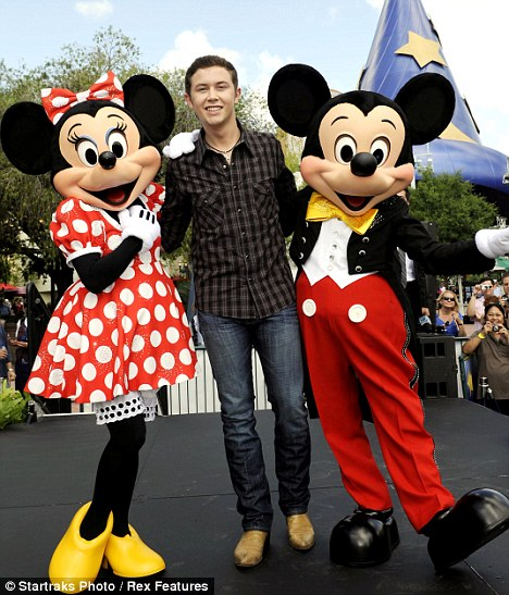 America's Idol Scotty McCreery is mobbed by fans as he visits Disney World