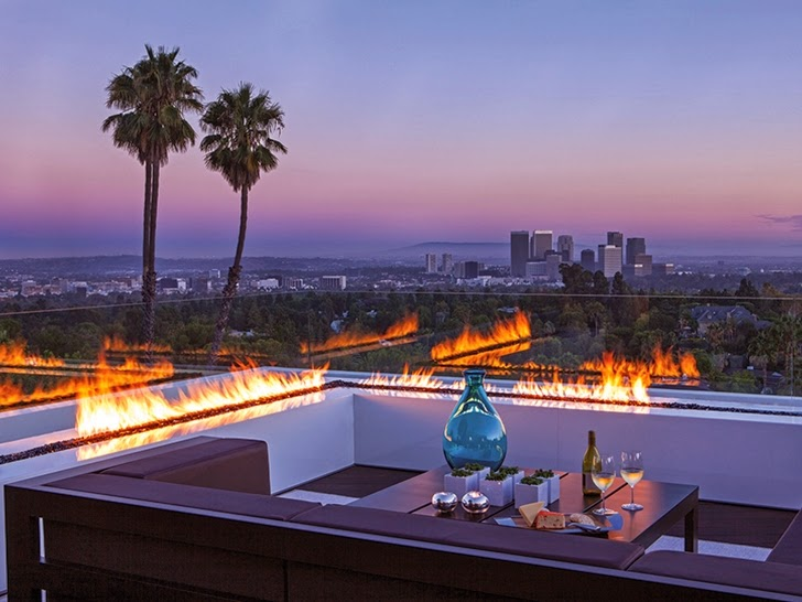 Outdoor fireplace in Perfect modern mansion in Beverly Hills