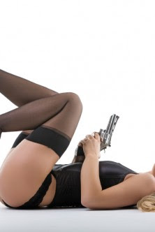 blonde lying on back with 357 magnum pistol