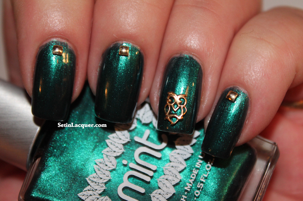 Nail art with Mint Nail Polish, Hex Charms and gold square studs