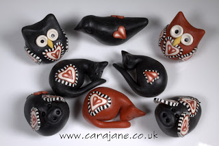 Lovely polymer clay heart decorated creatures by Cara Jane