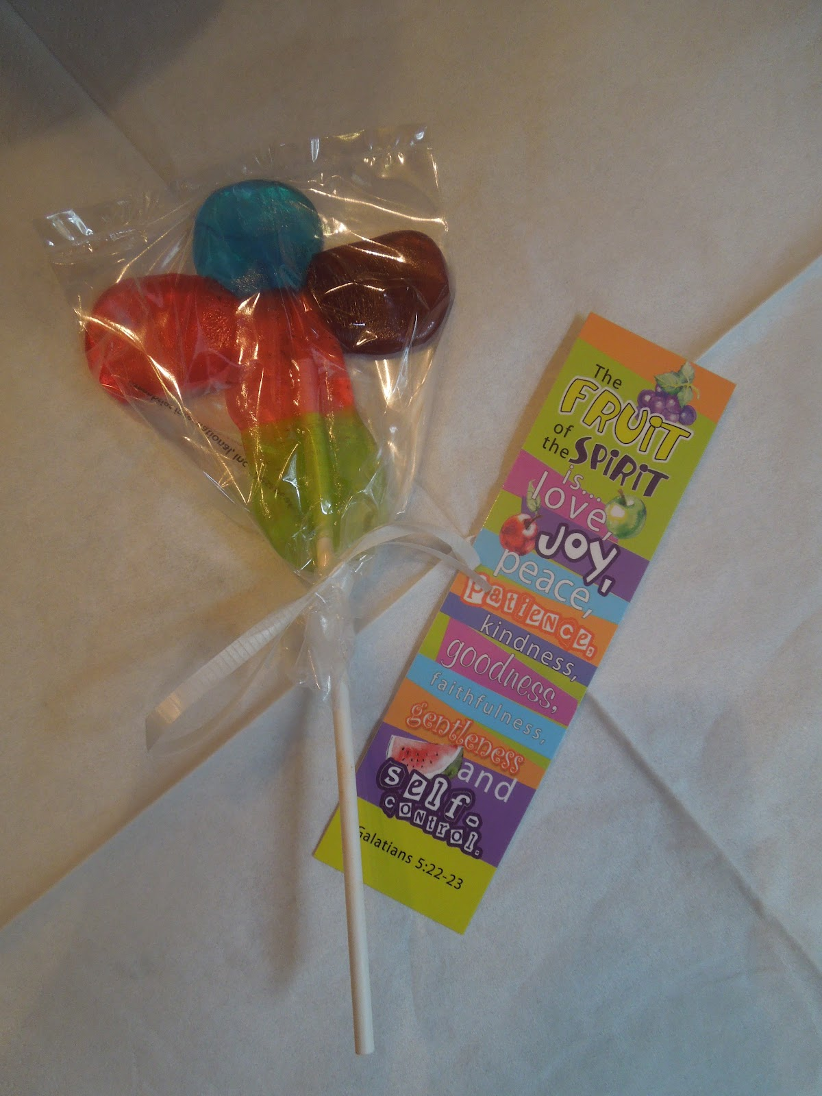 We wrapped them in cellophane bags with ribbon and put them with a fruit of the spirit bookmark. Print It Now! Jolly Rancher Suckers