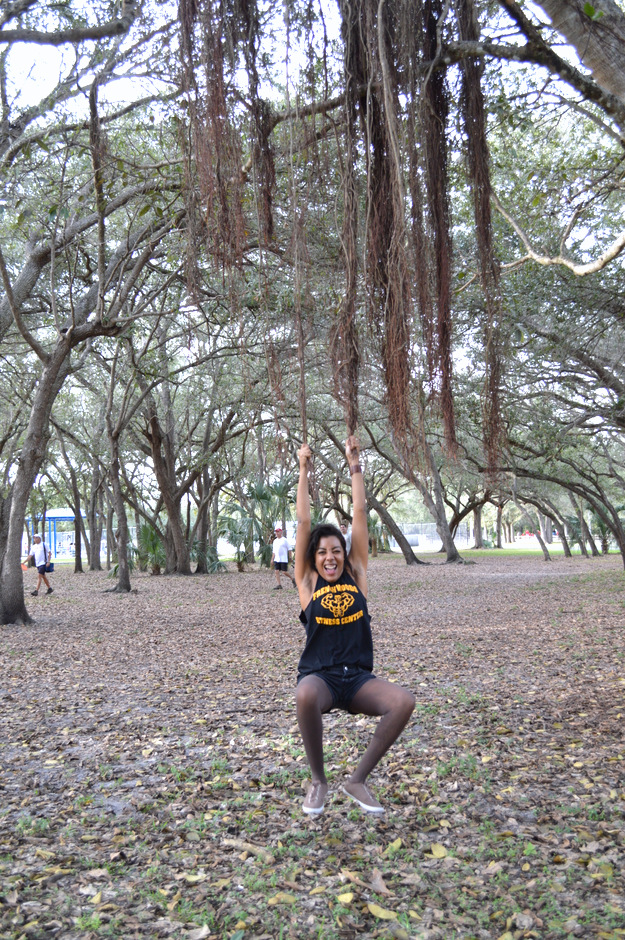 Fashion Blogger Anais Alexandre of Down to Stars wearing a DIY American Apparel t-shirt with Forever 21 shorts and Urban Outfitter shoes swinging from a tree vine