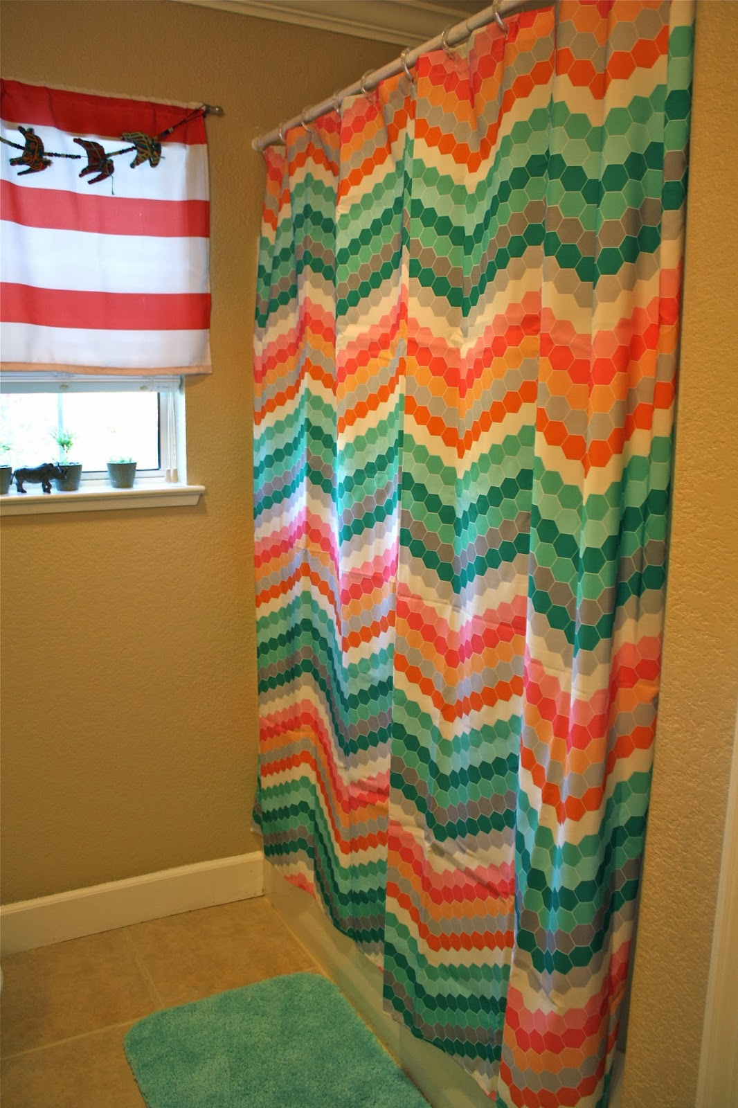 Aqua Chevron Shower Curtain - For my shower curtain and bathmat i turned to target i picked up this chevron curtain and love the punch of color it gives this otherwise average bathroom