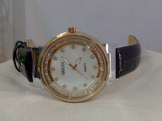 jam tangan gucci bulat
