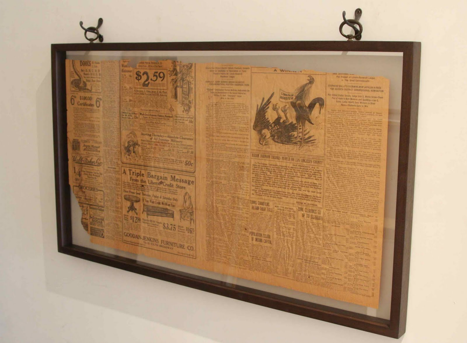 the challenge was to frame this 100 year old piece of newspaper so it could be viewed from both sides it is suspended between uv glass and uv plexiglas