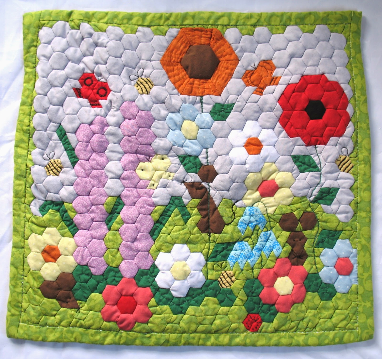 https://www.etsy.com/listing/187668060/patchwork-mini-quilt-summer-wild-flowers?ref=shop_home_feat_1