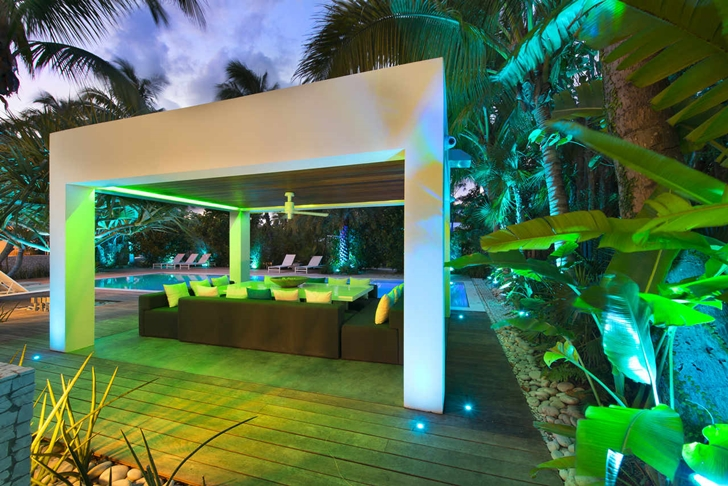 Covered terrace in Modern mansion in Miami at night