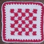 http://www.crochetnmore.com/checkeredhotpad.htm