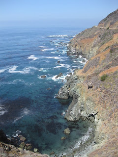 Turquoise cove with kelp along the rocky California Pacific coastline.