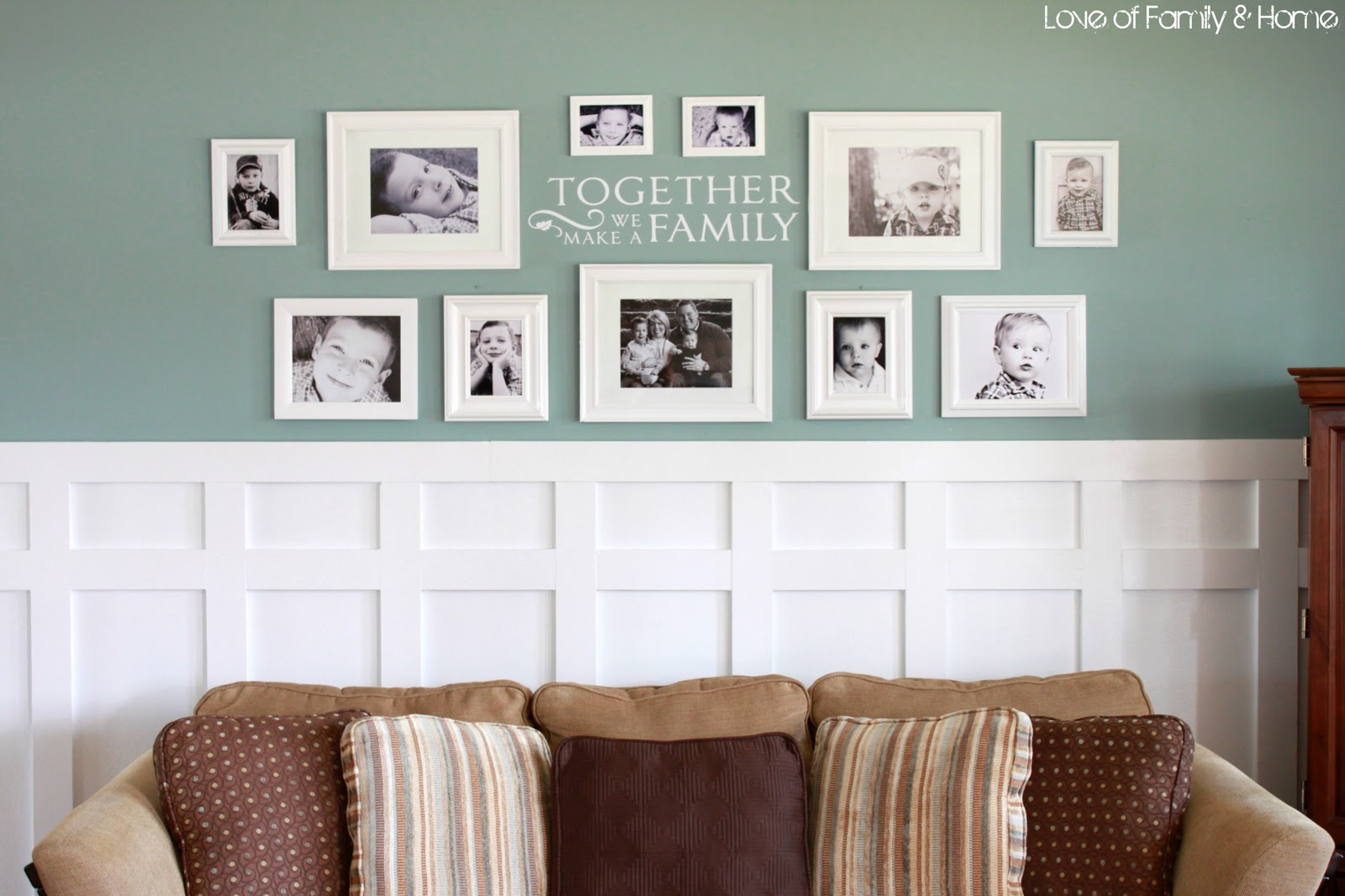 Board batten gallery wall in the living room love of family home Family pictures on living room wall