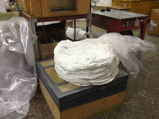 polyester fiber compressed before it is placed in cartons or picked up