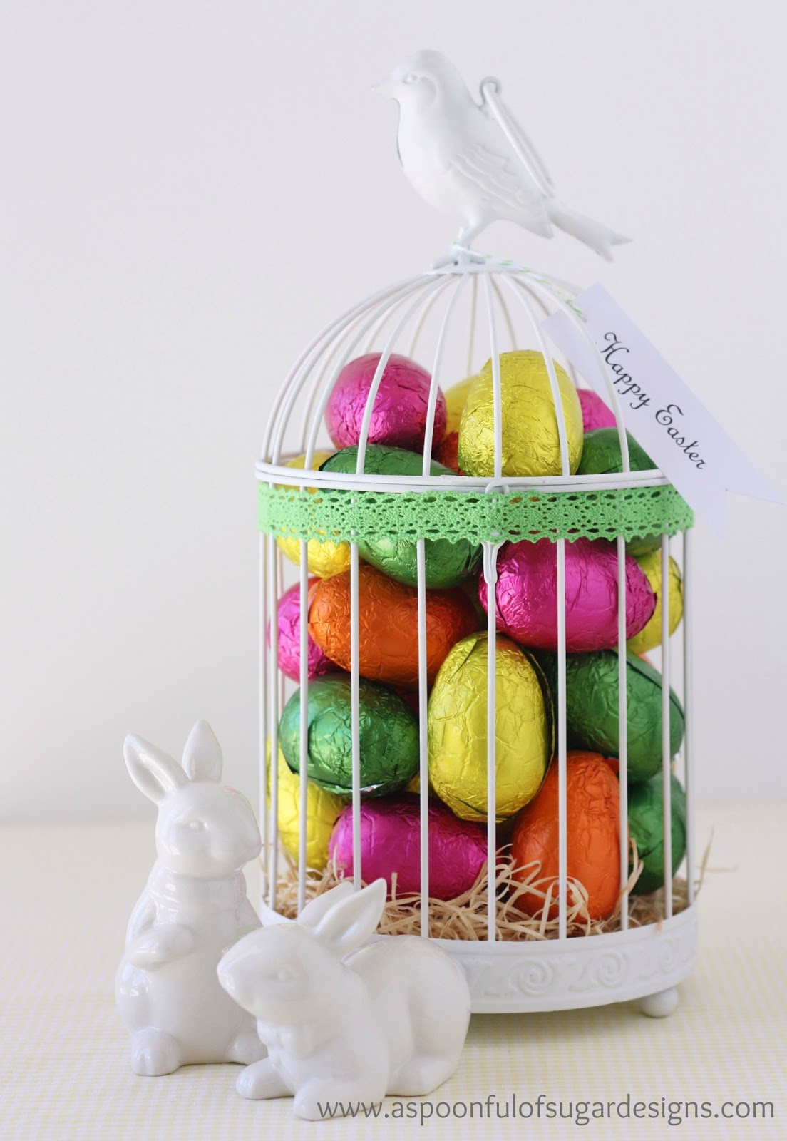 Easter gift ideas a spoonful of sugar quick easter table centrepiece by filling a home dcor item such as this candle birdcage with colourful chocolate eggs this idea would also work well negle