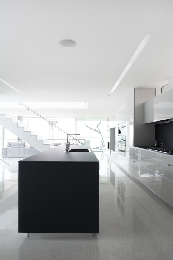 Minimalistic kitchen in Modern mansion on the beach by Dan Brunn