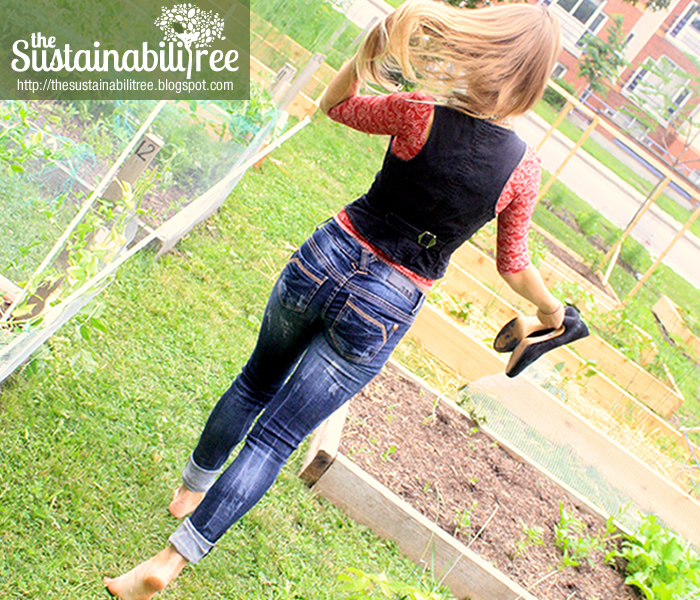 A student runs through the community gardens carefree