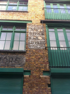 Ghost sign, Brownlow Mews, London