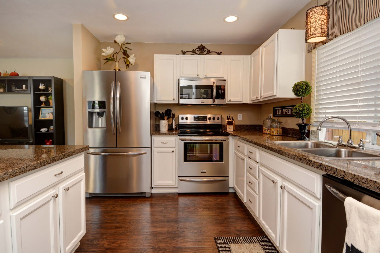 The Same Laminate Flooring From Living Room Was Extended Into Kitchen Had Cabinets Professionally Painted Replaced Formica Counters With