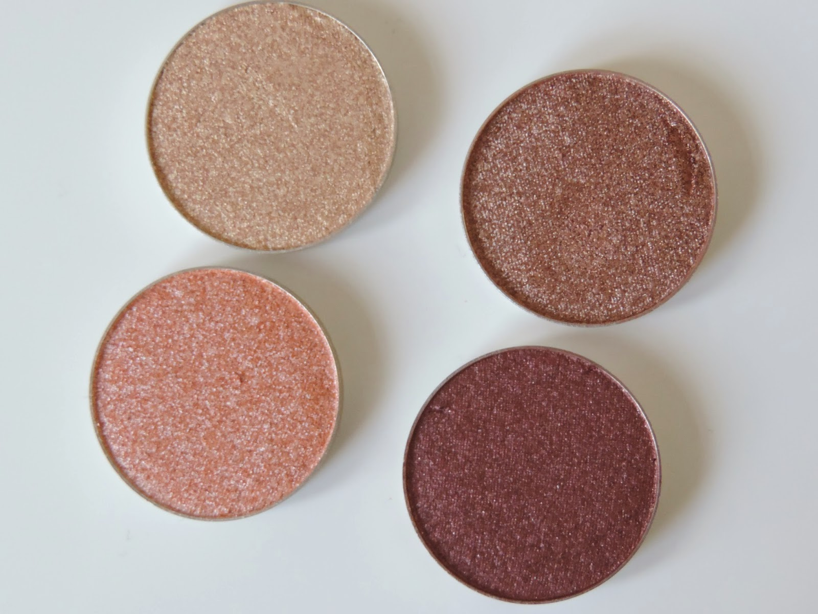 Makeup Geek Foiled Eyeshadows (clockwise) Grandstand, Showtime, In The Spotlight, Magic Act