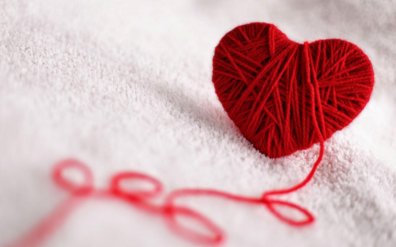 Corazón de hilo rojo
