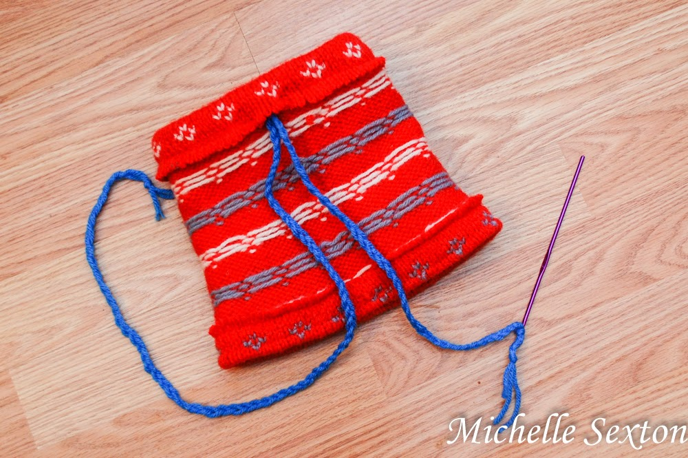 use a crochet hook to thread yarn through top opening