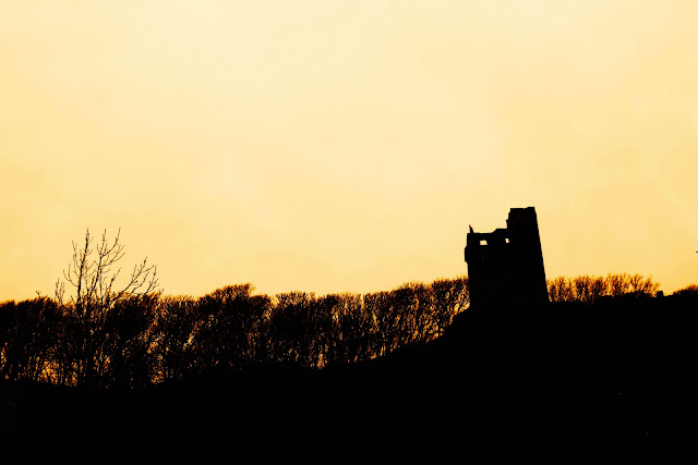 A silhouette view of a castle in Ireland.