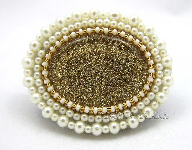 gold glitter brooch