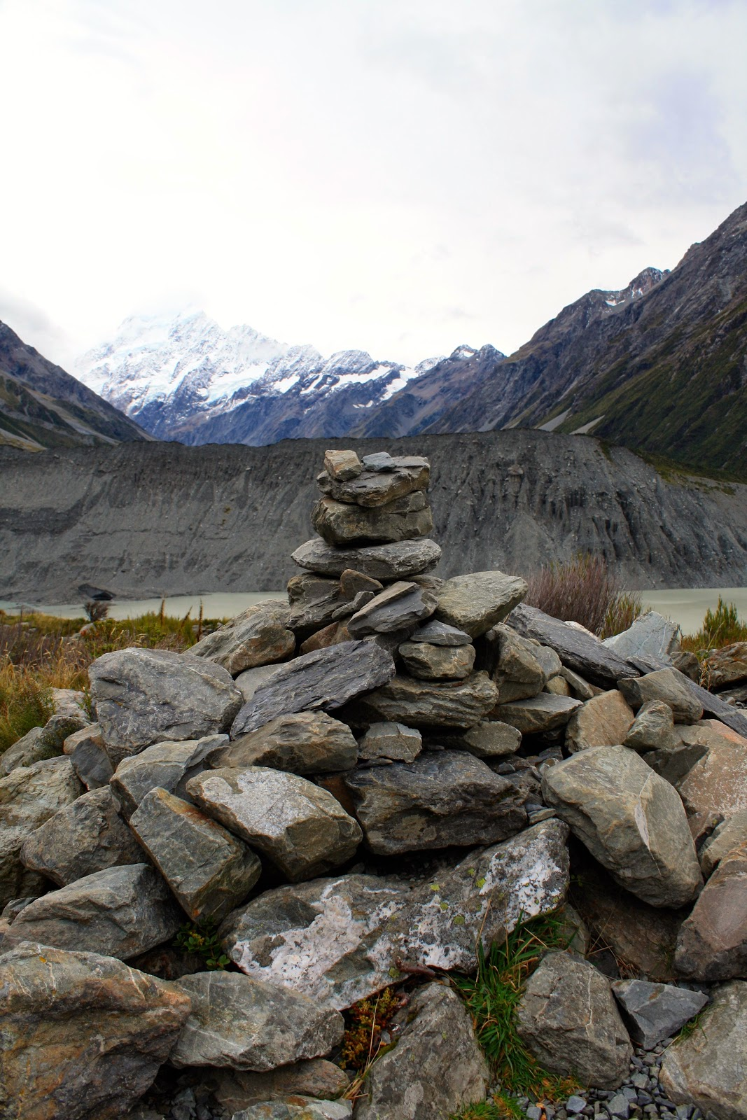 A cairn in front of Aoraki.