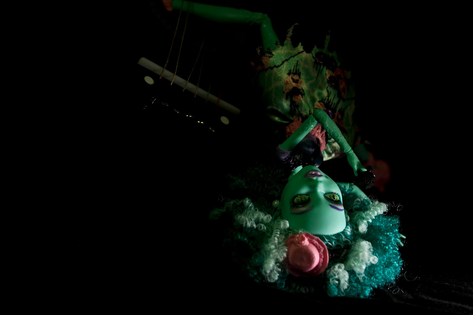 doll hanging upside down as she dies from a rock n roll concert