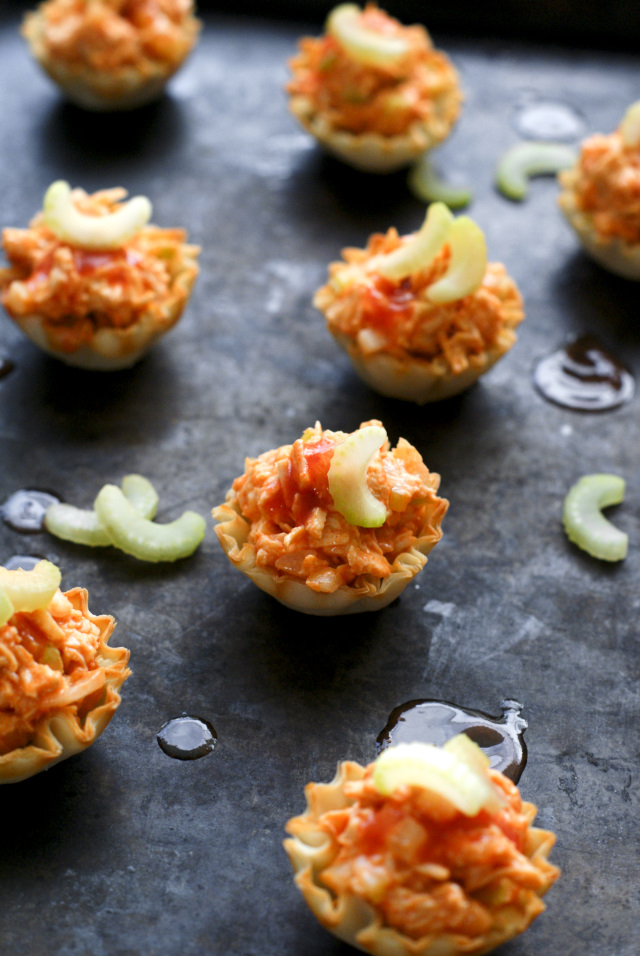 Buffalo Chicken Salad Bites are a spicy little bites of buffalo flavored chicken salad served in crisp phyllo cups.  Perfect appetizer for game day!